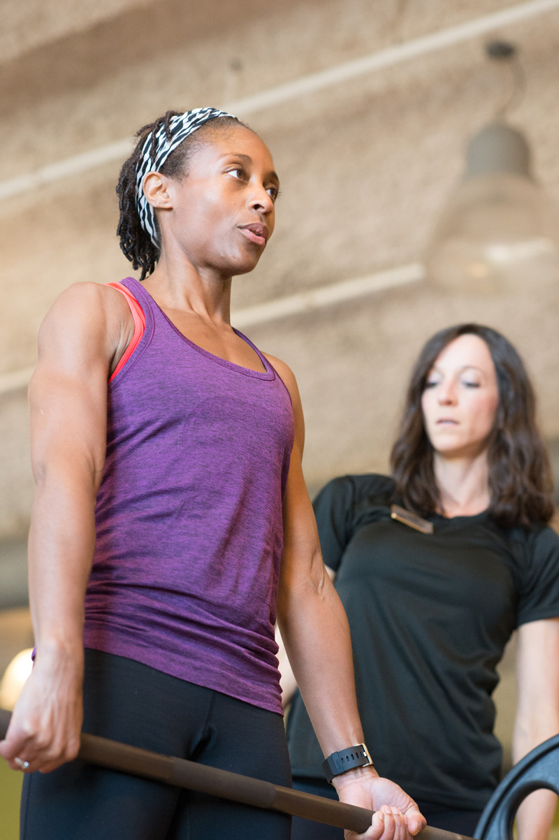 Woman Lifting Weights With a Personal Trainer | Colorado Athletic Club - Boulder