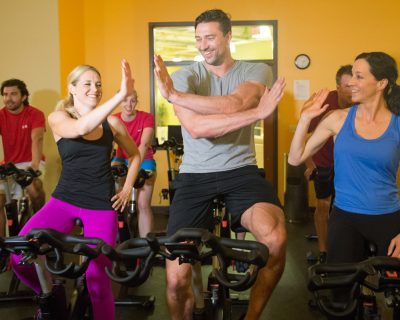 High Fives After a Group Spinning Class | Colorado Athletic Club - DTC | Athletic Club and Gym