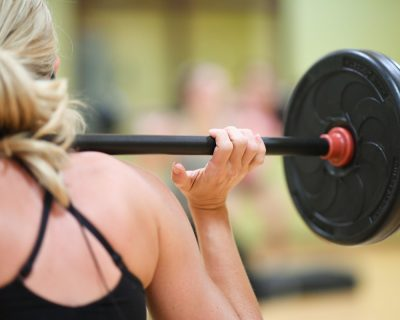 Woman Doing Weighted Squats | Colorado Athletic Club - Flatirons
