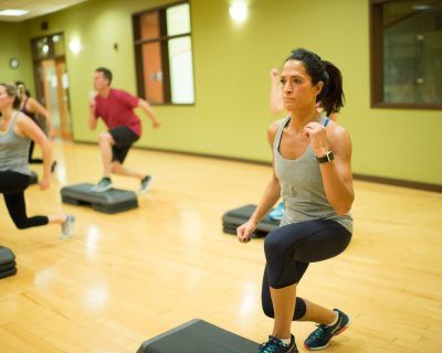 Woman Working Out Legs in a Group Class | Colorado Athletic Club - Flatirons