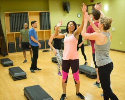 High Fives After a Group Step Class | Colorado Athletic Club - Flatirons