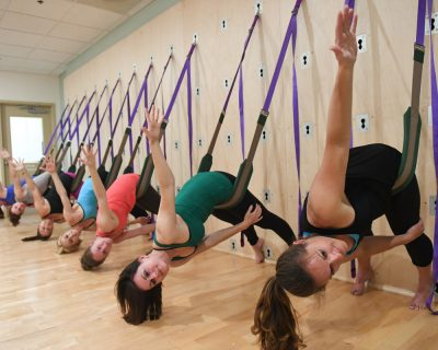Group of Students Taking a Yoga Wall Class | Colorado Athletic Club - Union Station