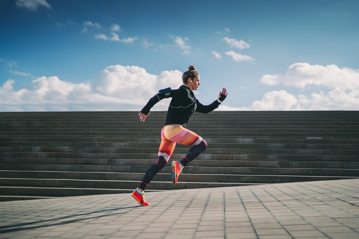 Sportswoman sprinting in the city